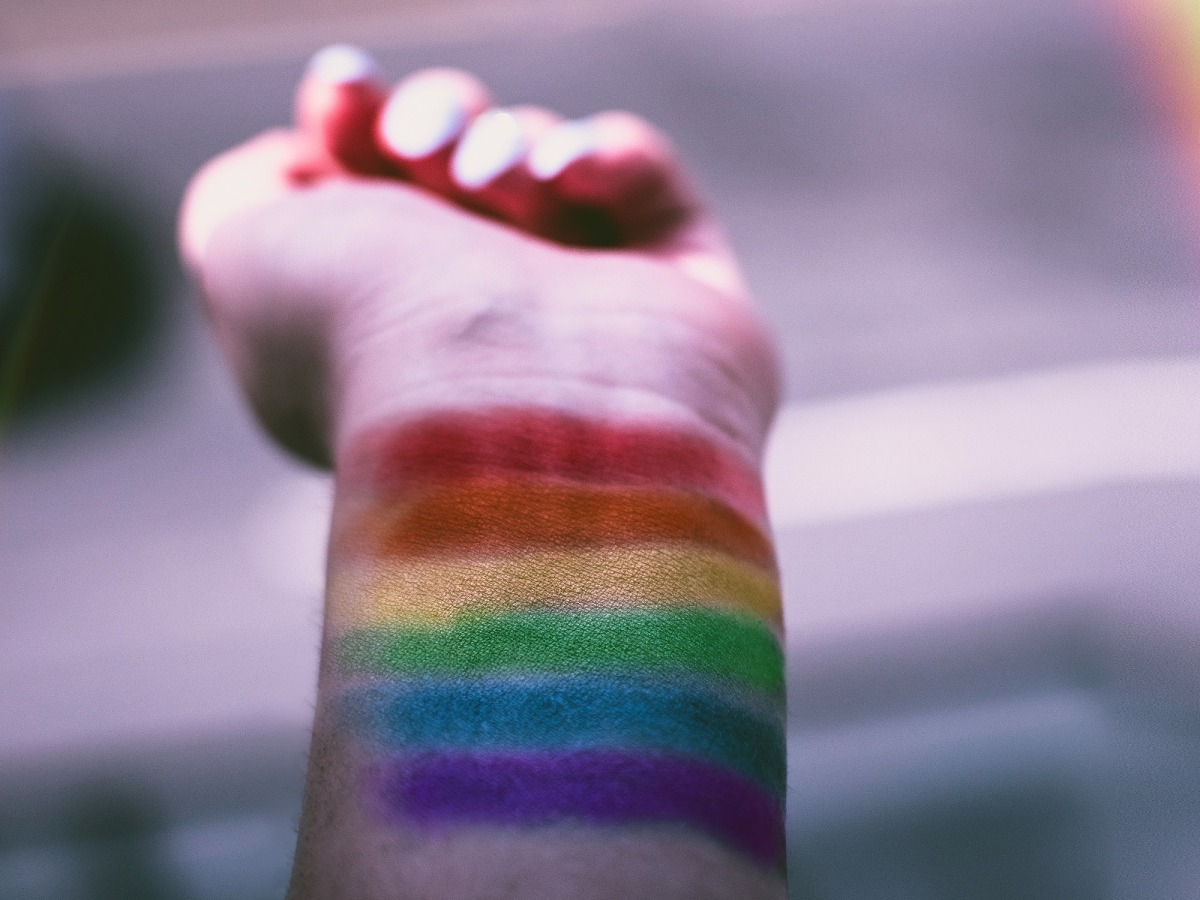 A rainbow painted on a person's wrist