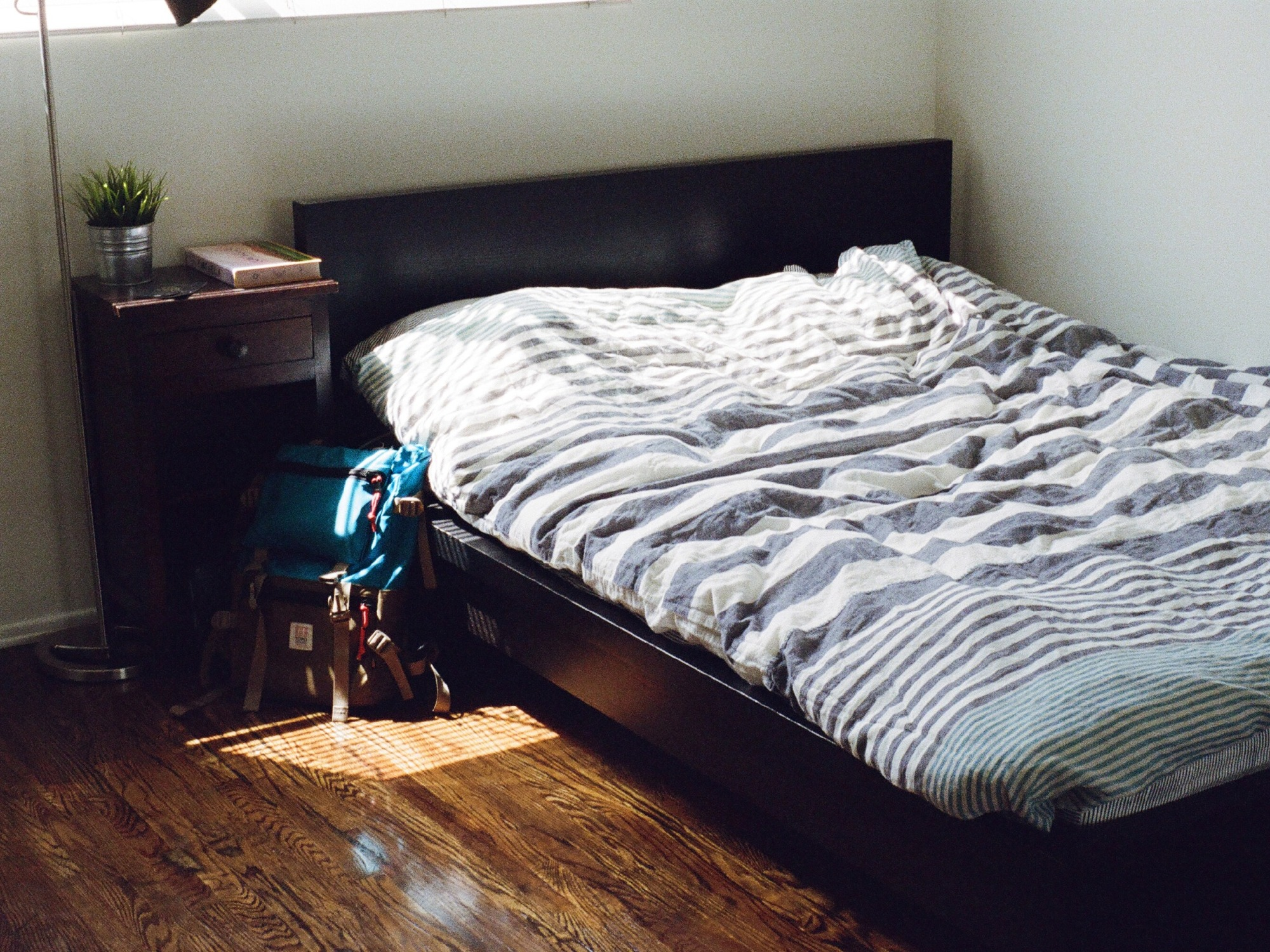 A bed and bedside table