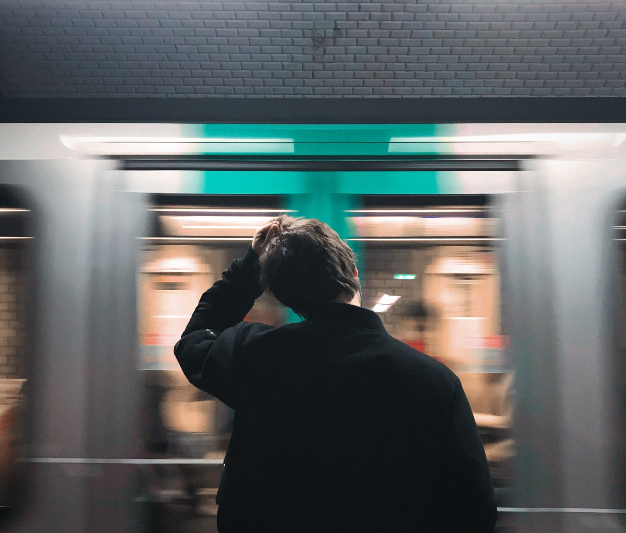 A young person waiting for the train