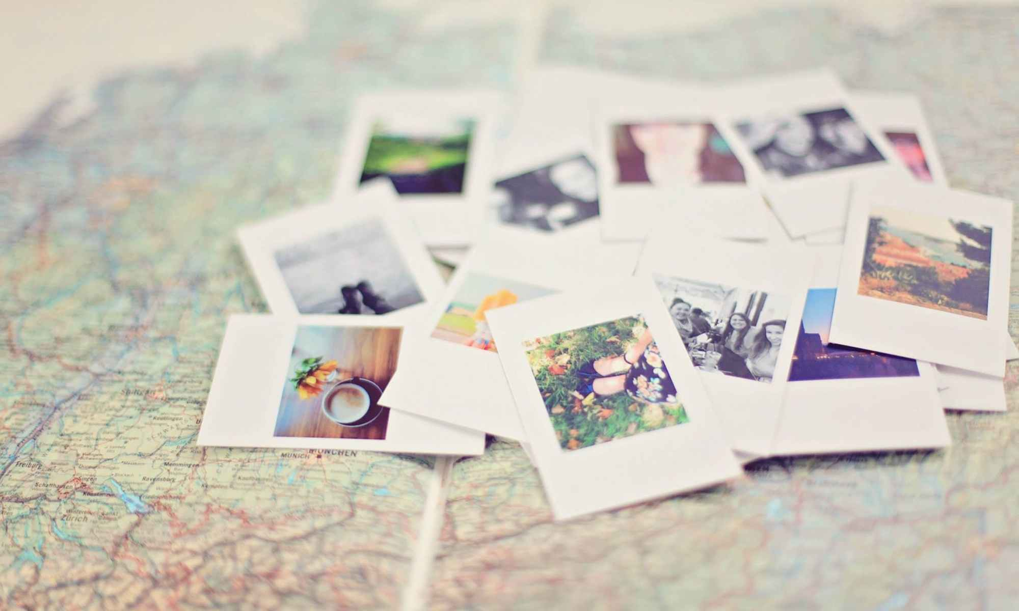 Stack of Polaroid pictures on top of a map