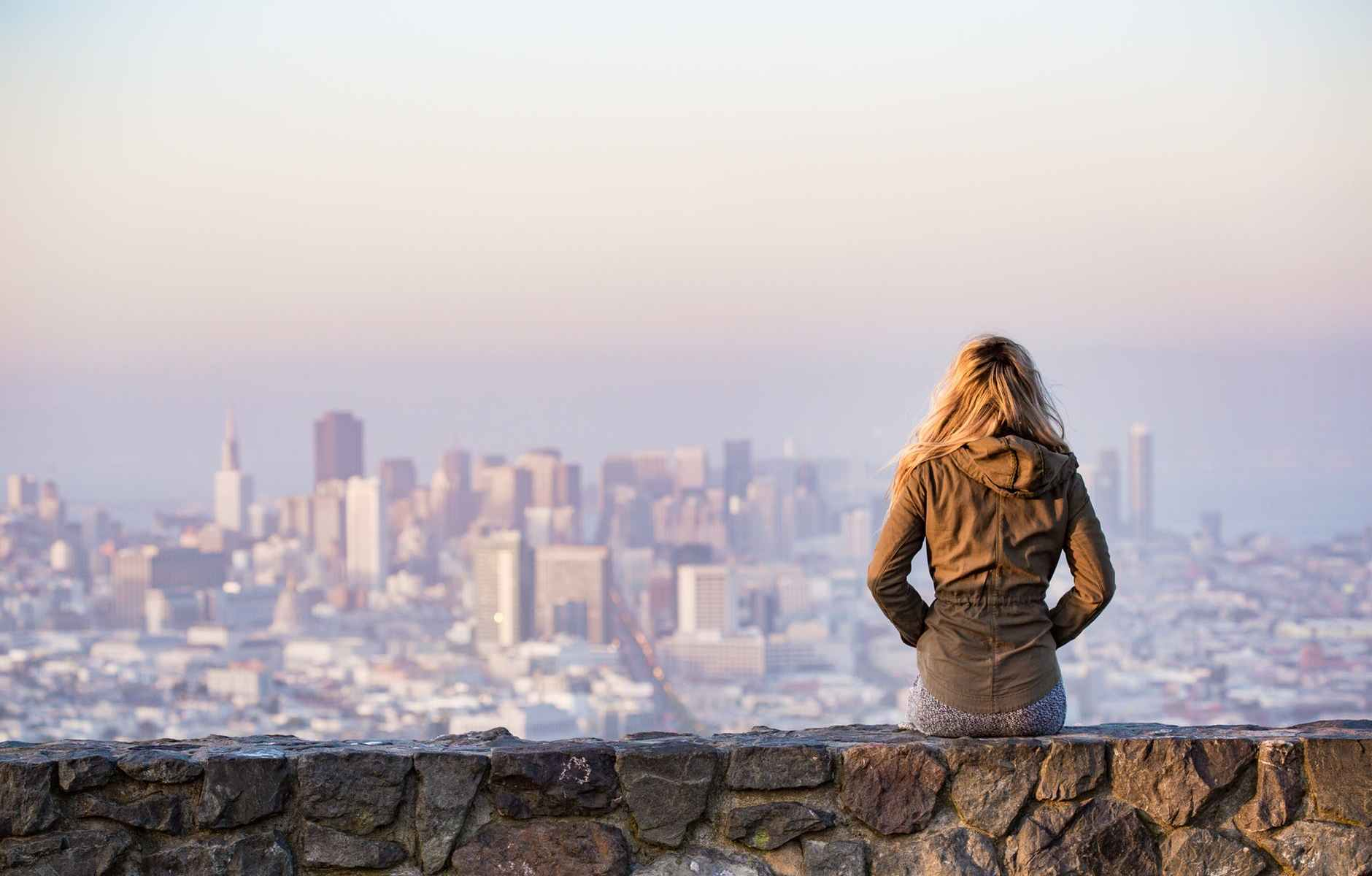 Young woman overlooking a city